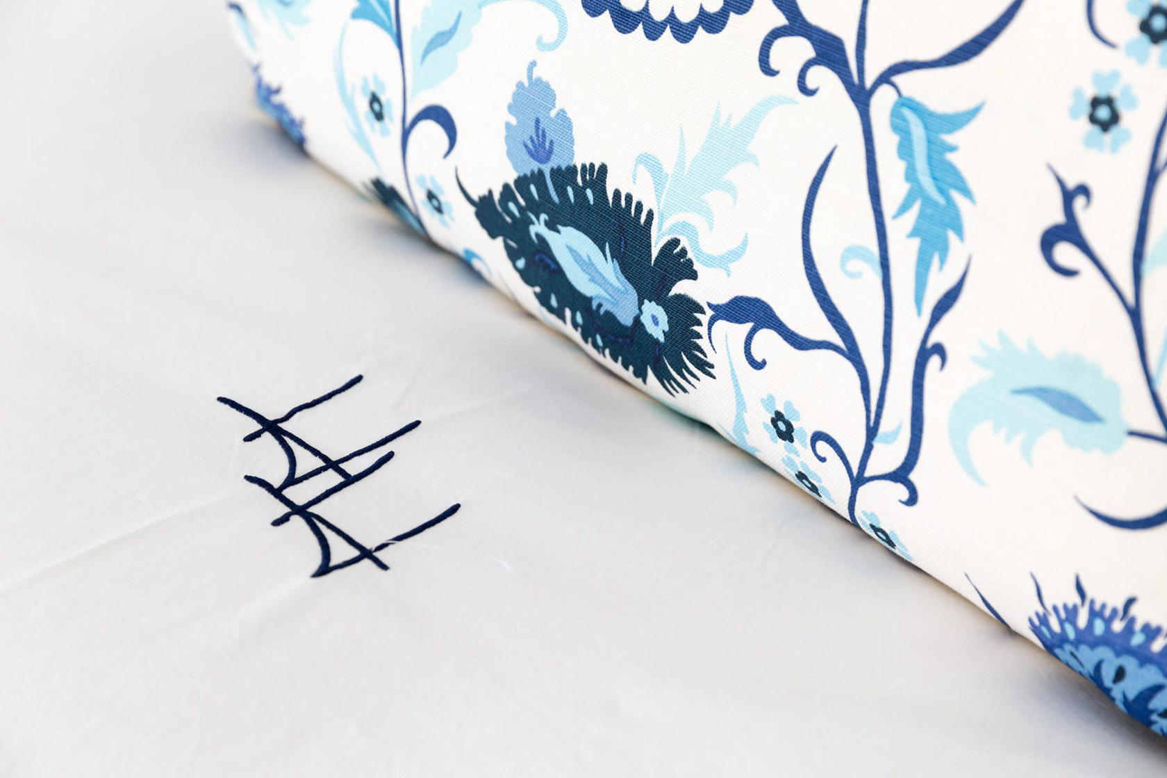 HH embroidery on bedsheets